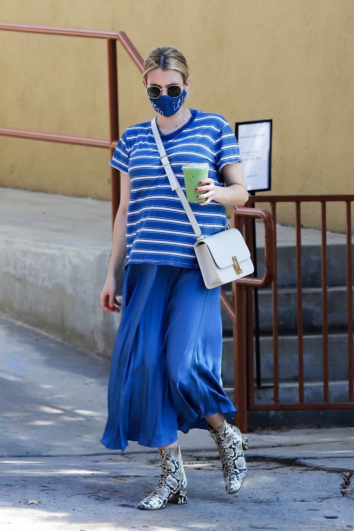 Emma Roberts displays her growing belly in all-blue while out running errands in Los Feliz, California