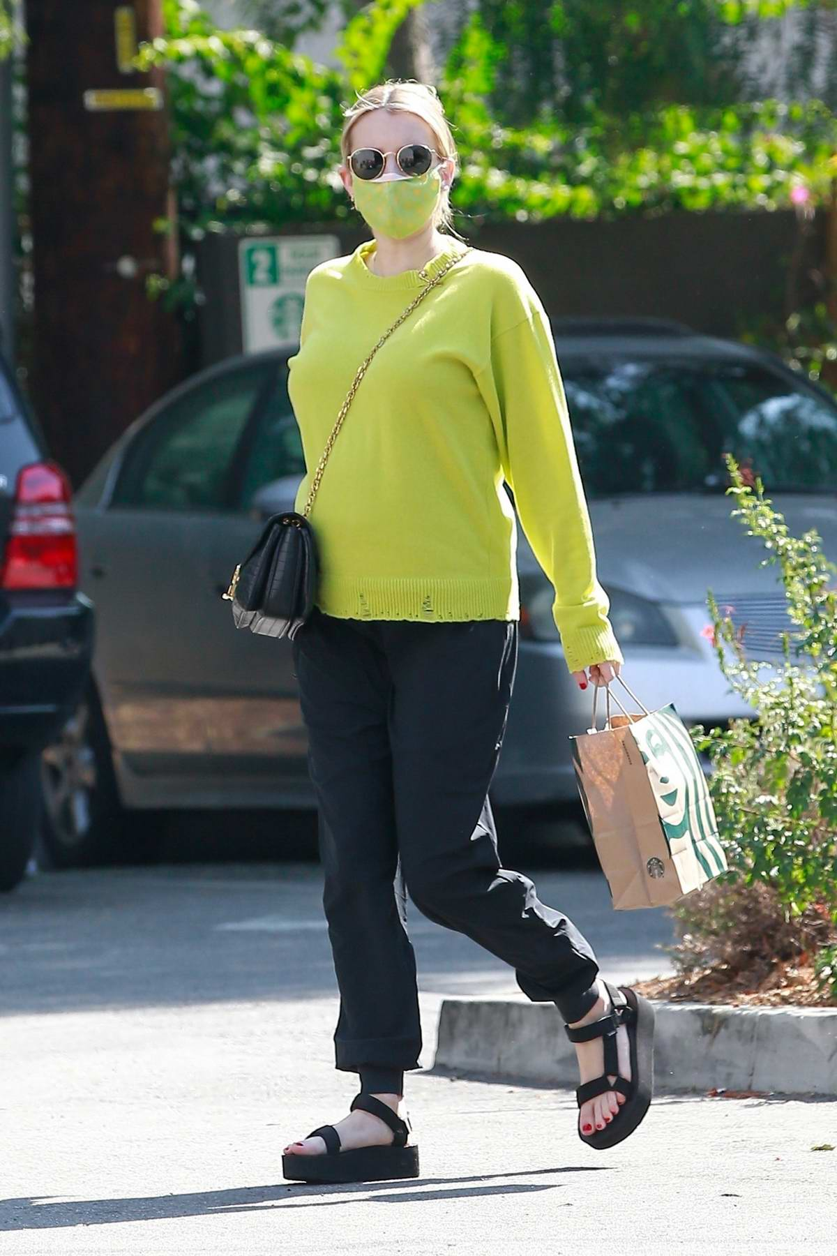 Emma Roberts puts her baby bump on display during a Starbucks run in Los Feliz, California