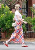 Emma Roberts shows her growing baby bump in a colorful dress while running errands in Los Feliz, California