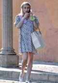 Emma Roberts wears a cute floral dress while visiting a friend with Garrett Hedlund in Los Angeles