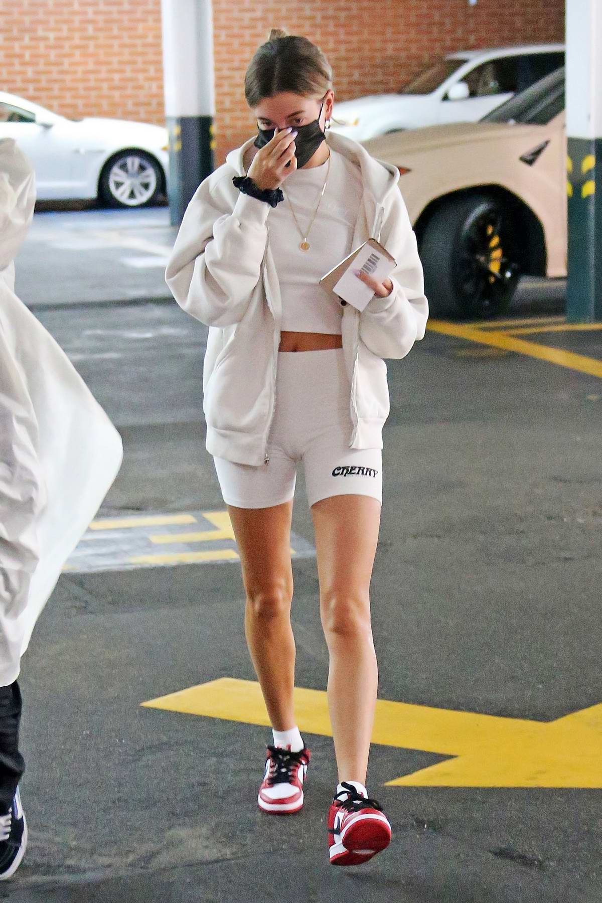 Hailey Bieber flashes her toned abs and legs while visiting a medical building in Beverly Hills, California