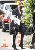 Hailey Bieber puts on a stylish display as she steps out during Milan Fashion Week in Milan, Italy