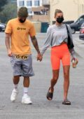 Hailey Bieber rocks bright orange bike shorts while heading for Pilates class with Justin Bieber in Beverly Hills, California