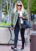 Hilary Duff sports a green bomber jacket and leggings while making a coffee run in Los Angeles