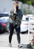Hilary Duff wears a green bomber jacket and black leggings while out running errands in Los Angeles