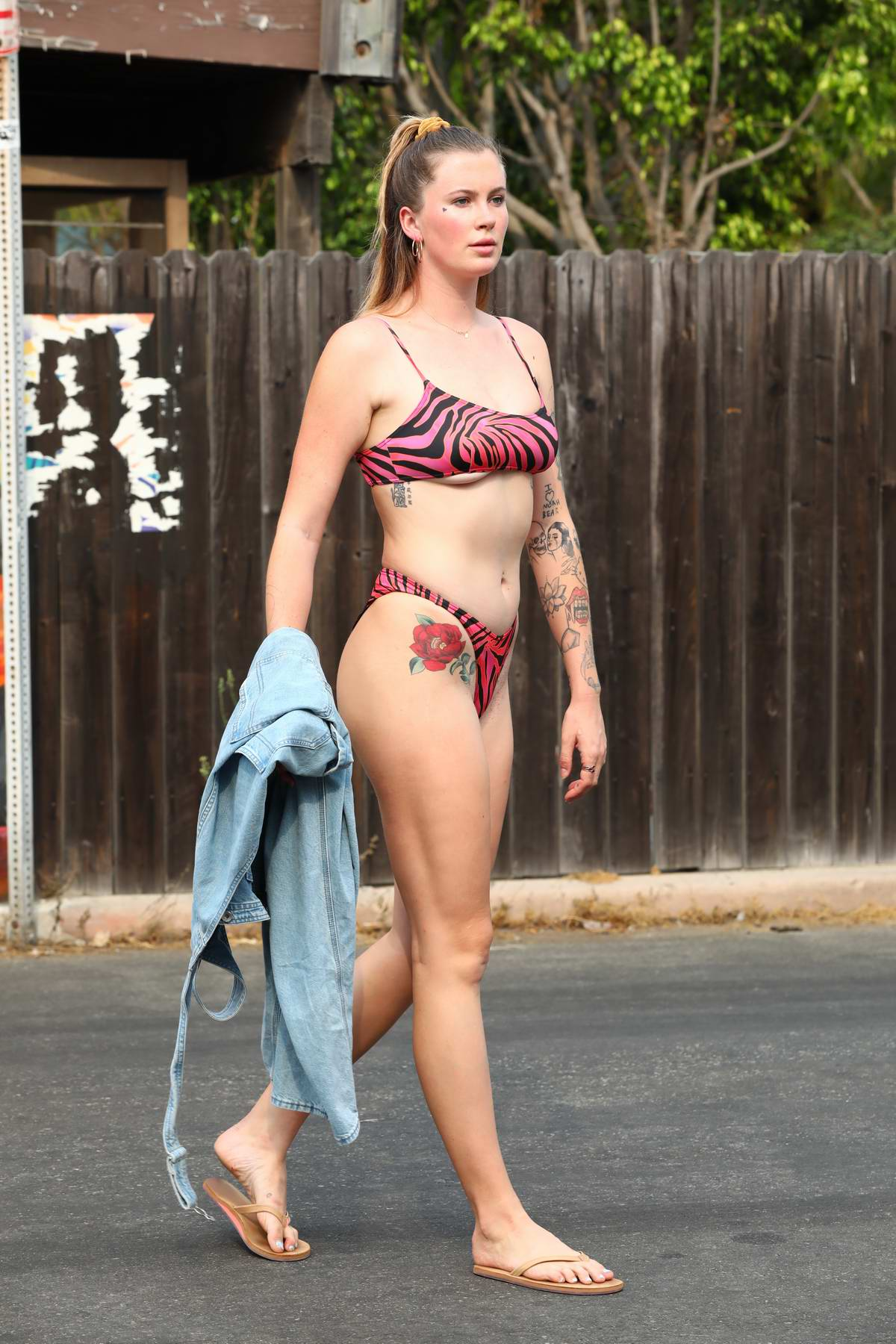 Ireland Baldwin seen wearing PrettyLittleThing's Hot Pink Zebra Print bikini in Malibu, California
