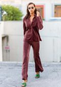 Irina Shayk looks stylish in maroon ensemble while out during the Milan Fashion Week in Milan, Italy