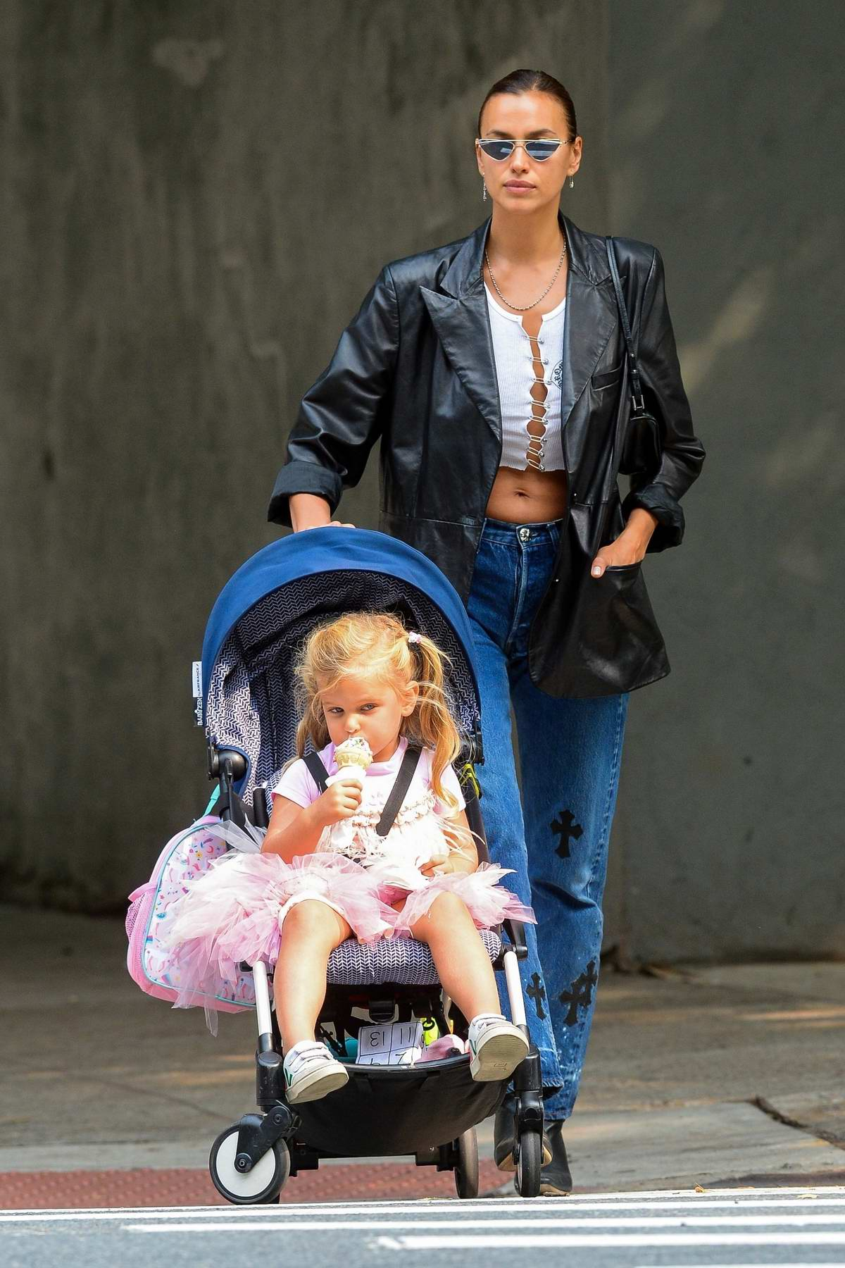 Irina Shayk puts her toned abs on display while on a stroll with her daughter Lea in New York City