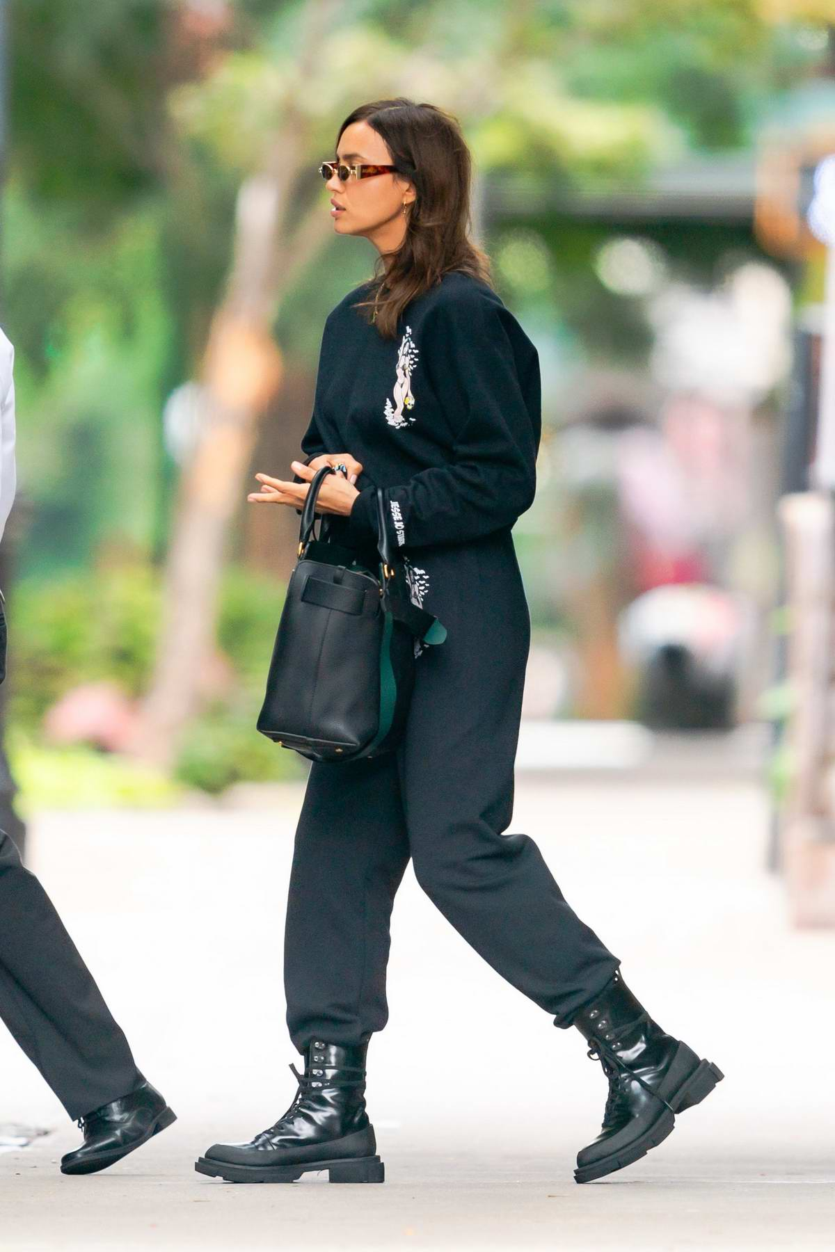 Irina Shayk steps out wearing an all-black sweatsuit and combat boots in New York City