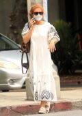 Isla Fisher wears an embroidered Tory Burch white dress while out running errands in Los Angeles