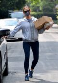 Jennifer Garner picks up a box from the post office while out running errands in Brentwood, California