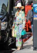 Jennifer Lopez dons a colorful dress as she leaves a building with Alex Rodriguez in New York City