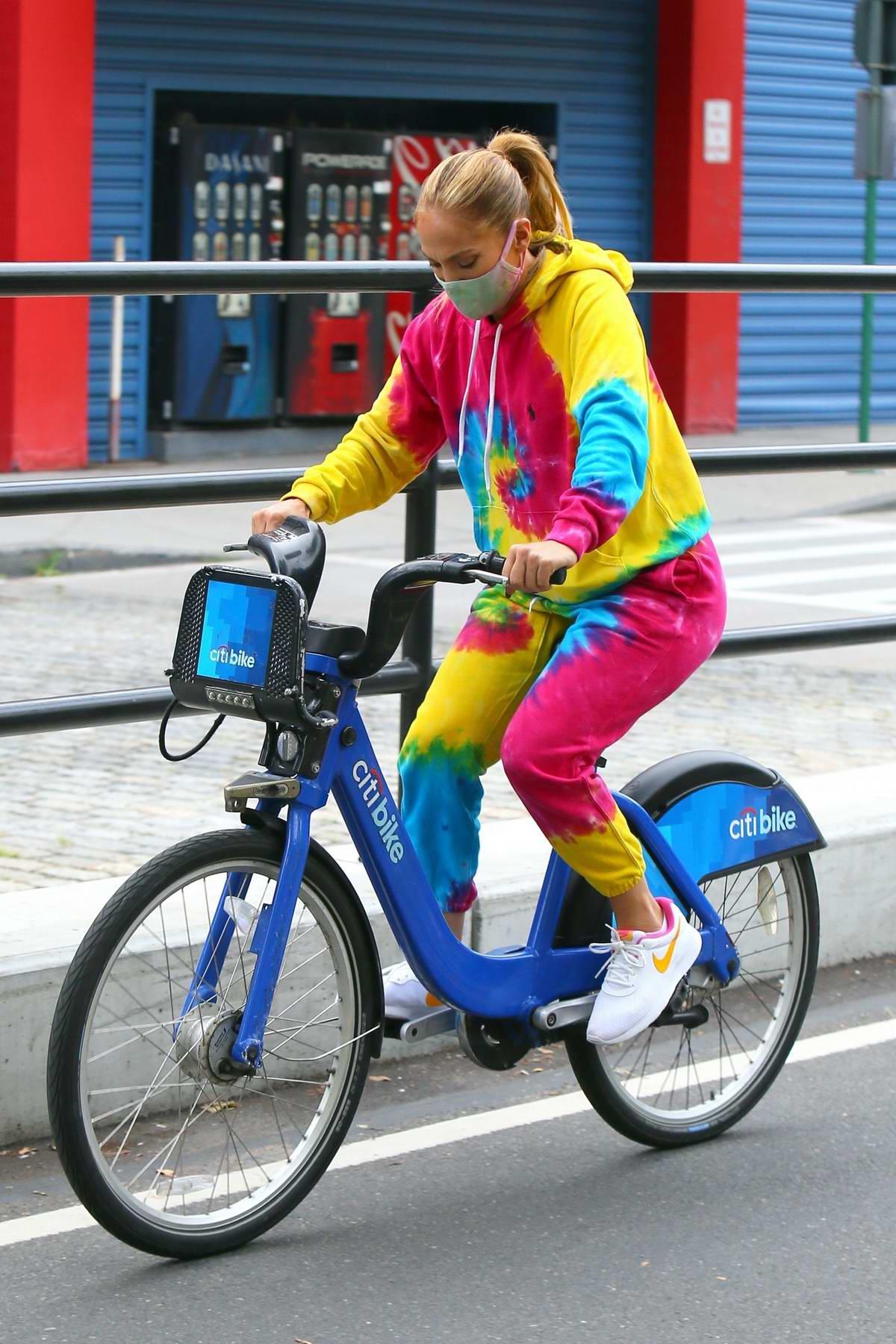 Jennifer Lopez wears colorful tie-dye sweats while riding a City bike in New York City