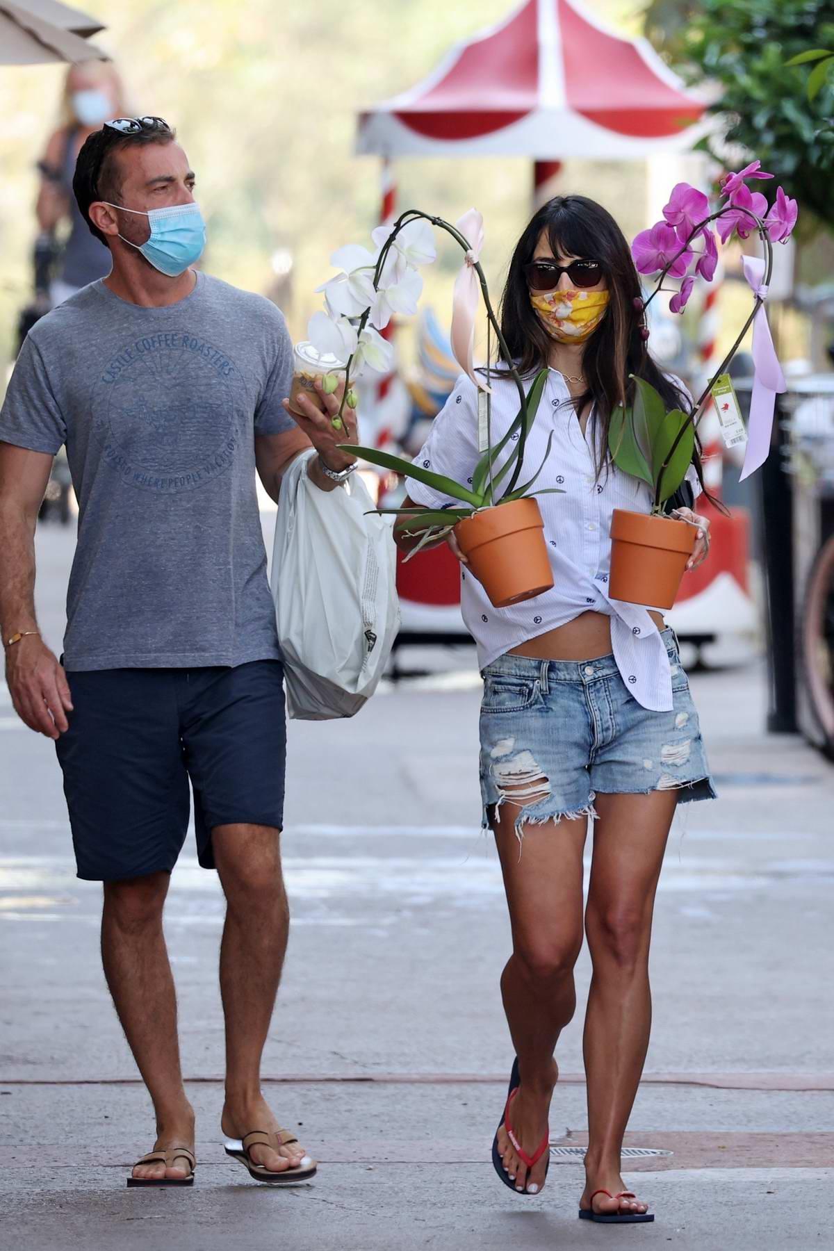 Jordana Brewster picks up some Orchids during a coffee run with boyfriend Mason Morfit in Santa Monica, California