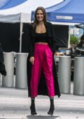 Josephine Skriver stands out in fuchsia pants while filming a new campaign for Maybelline on the streets of New York City
