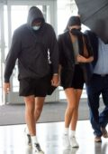 Kaia Gerber and Jacob Eldori hold hands as she they arrive at JFK Airport in New York City