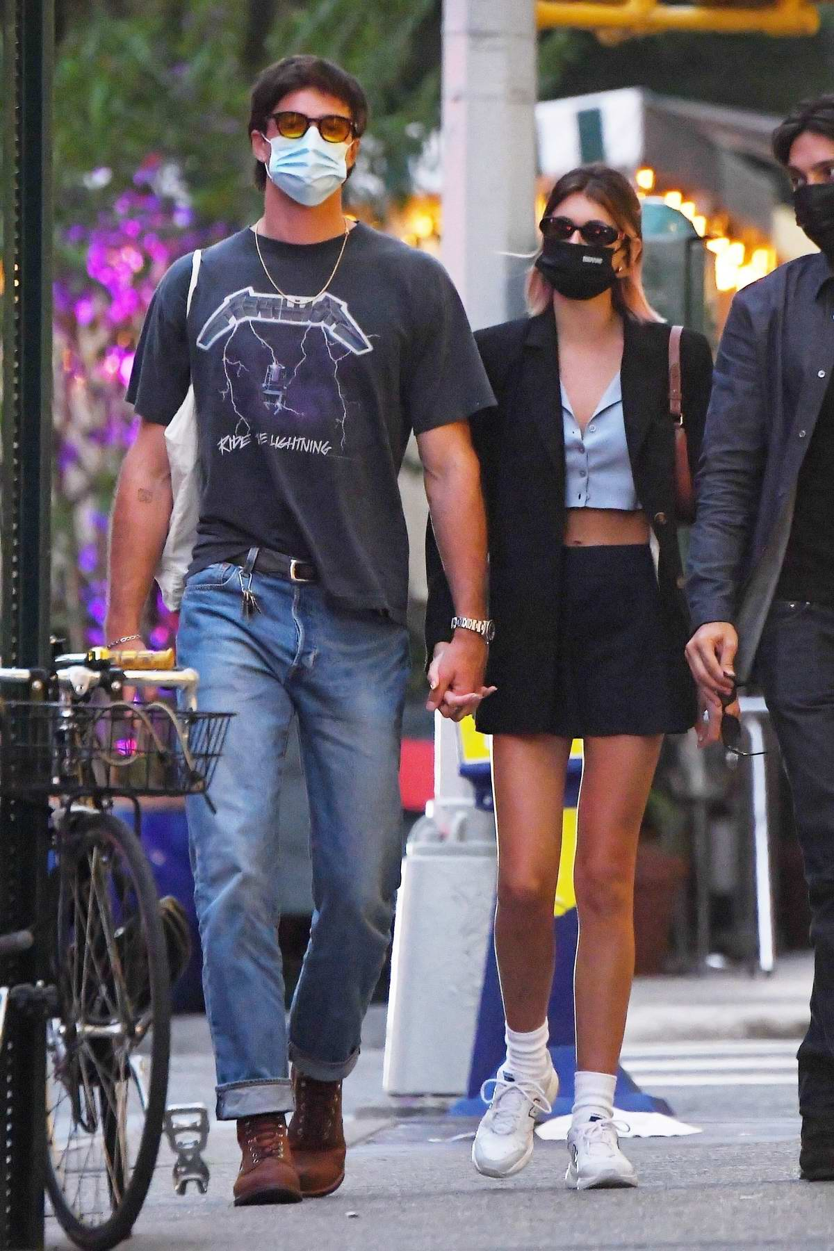 Kaia Gerber and Jacob Elordi hold hands as they walk to her apartment after a date night in New York City