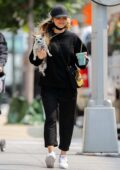 Kaley Cuoco enjoys a smoothie while taking her dog Dumpy for a stroll in New York City