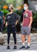 Kaley Cuoco sports a dark t-shirt and leggings as she steps out with husband Karl Cook in New York City