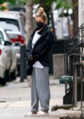 Kaley Cuoco takes her dog Dumpy out for a walk in New York City