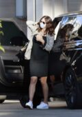 Katharine McPhee steps out wearing a form-fitting black dress while running errands in Los Angeles