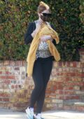 Katherine Schwarzenegger cradles one-month-old baby girl Lyla during a stroll in Brentwood, California