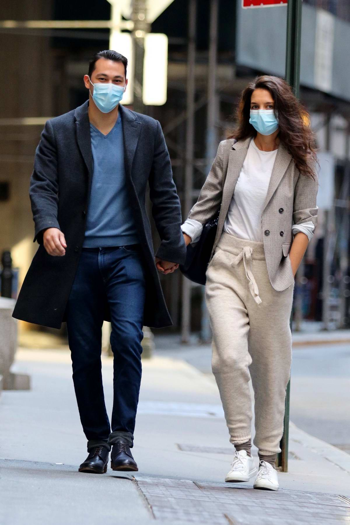 Katie Holmes and boyfriend Emilio Vitolo Jr walk hand-in-hand while out in New York City