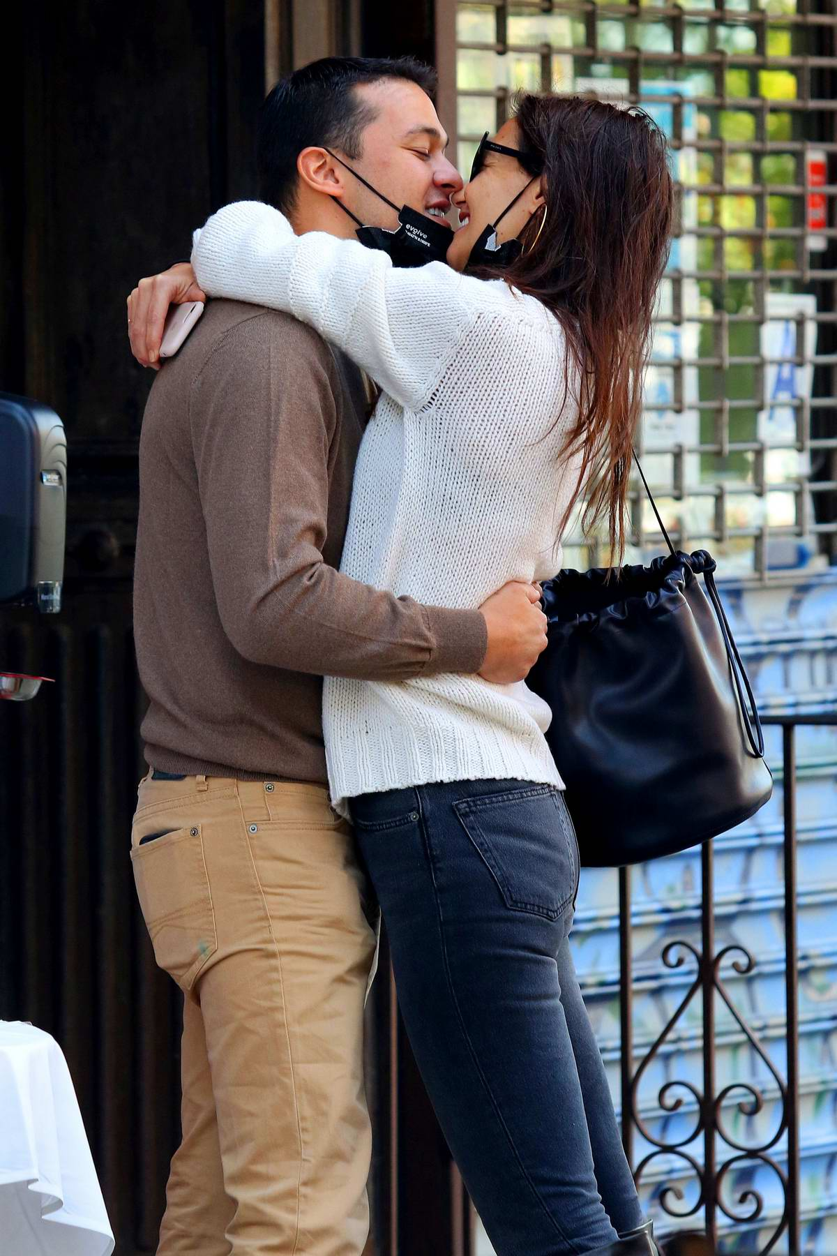 Katie Holmes and Emilio Vitolo Jr engage in some serious PDA outside his restaurant in New York City