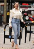 Kelly Brook dons a stylish blouse and denim as she arrives at Heart radio in London, UK