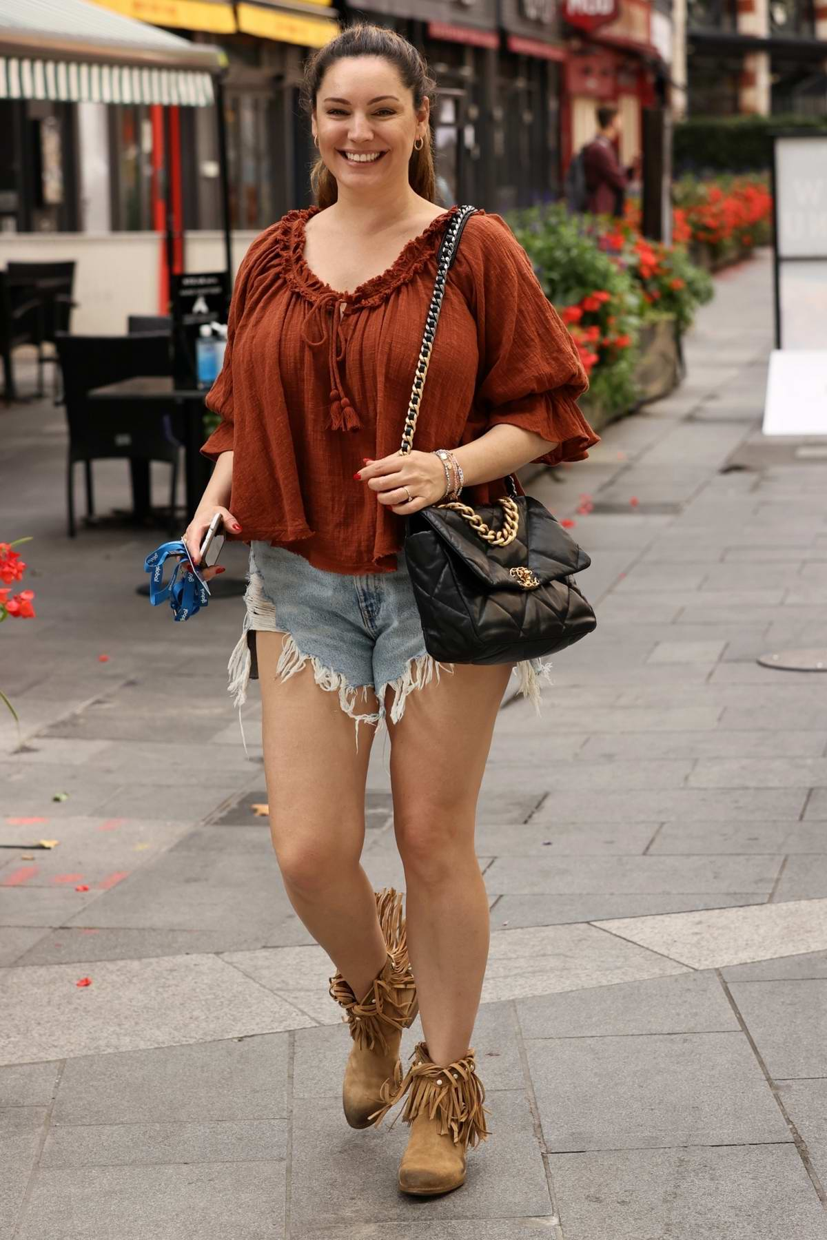 Kelly Brook is all smiles as she arrives at Global Studios wearing ripped denim shorts in London, UK
