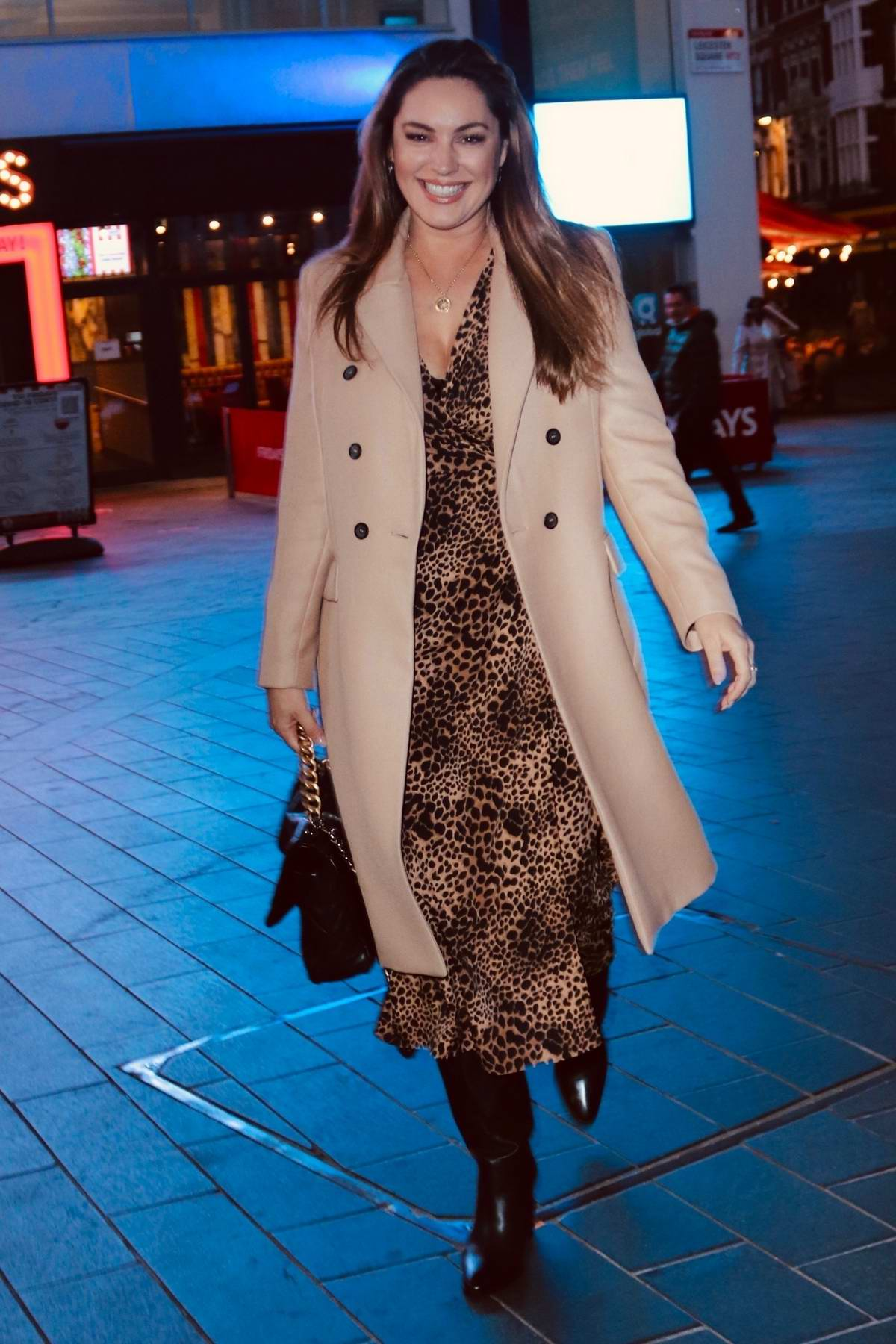 Kelly Brook is all smiles as she leaves the Global Radio wearing an animal print dress in London, UK