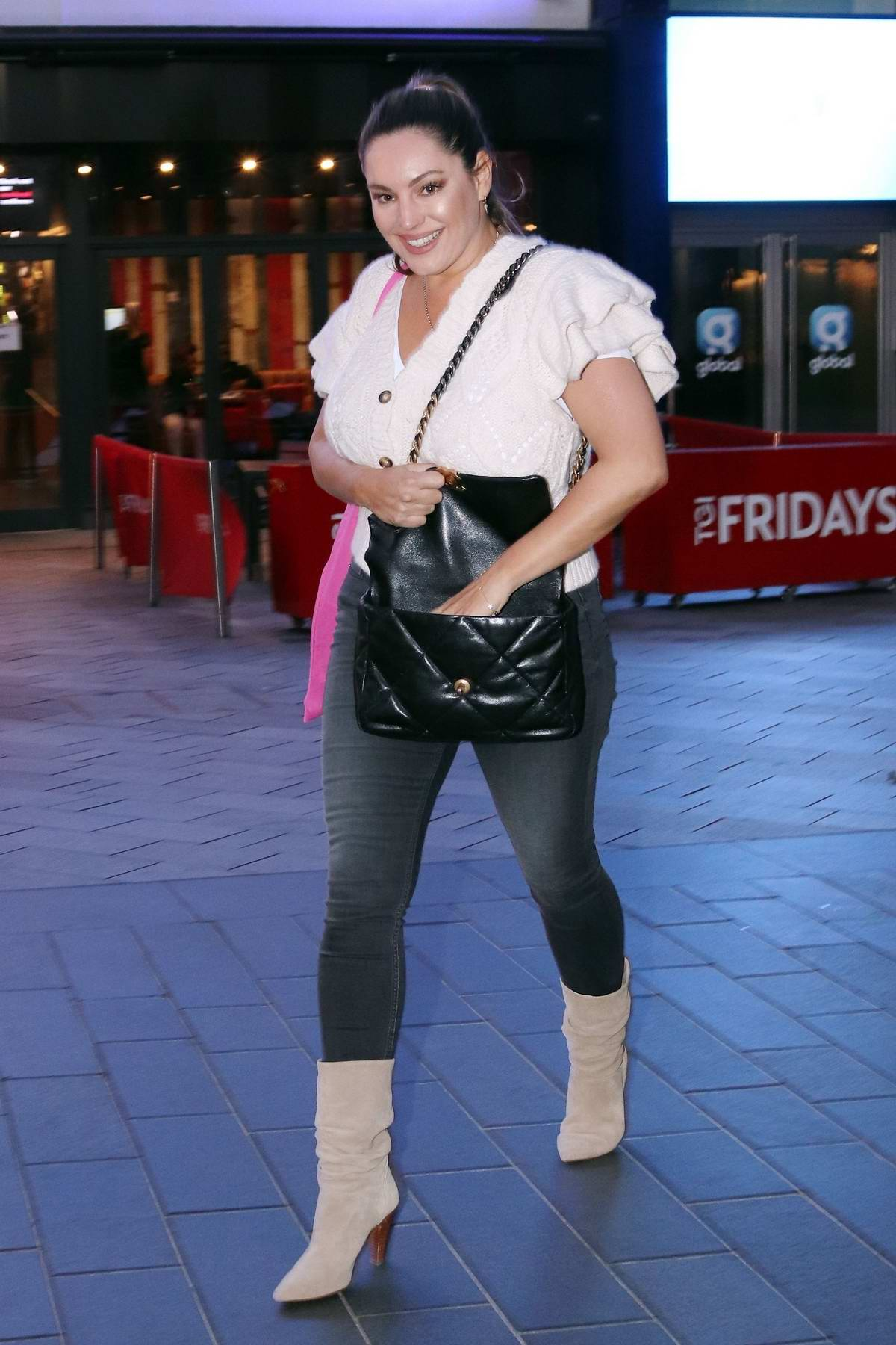 Kelly Brook is all smiles as she leaves the Global studios after hosting her radio show in London, UK