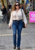 Kelly Brook looks chic in semi-sheer top and jeans as she arrives at the Global Radio Studios in London, UK