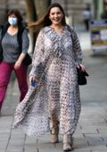 Kelly Brook looks great in a long flowing dress as she arrives at the Global Radio Studios in London, UK