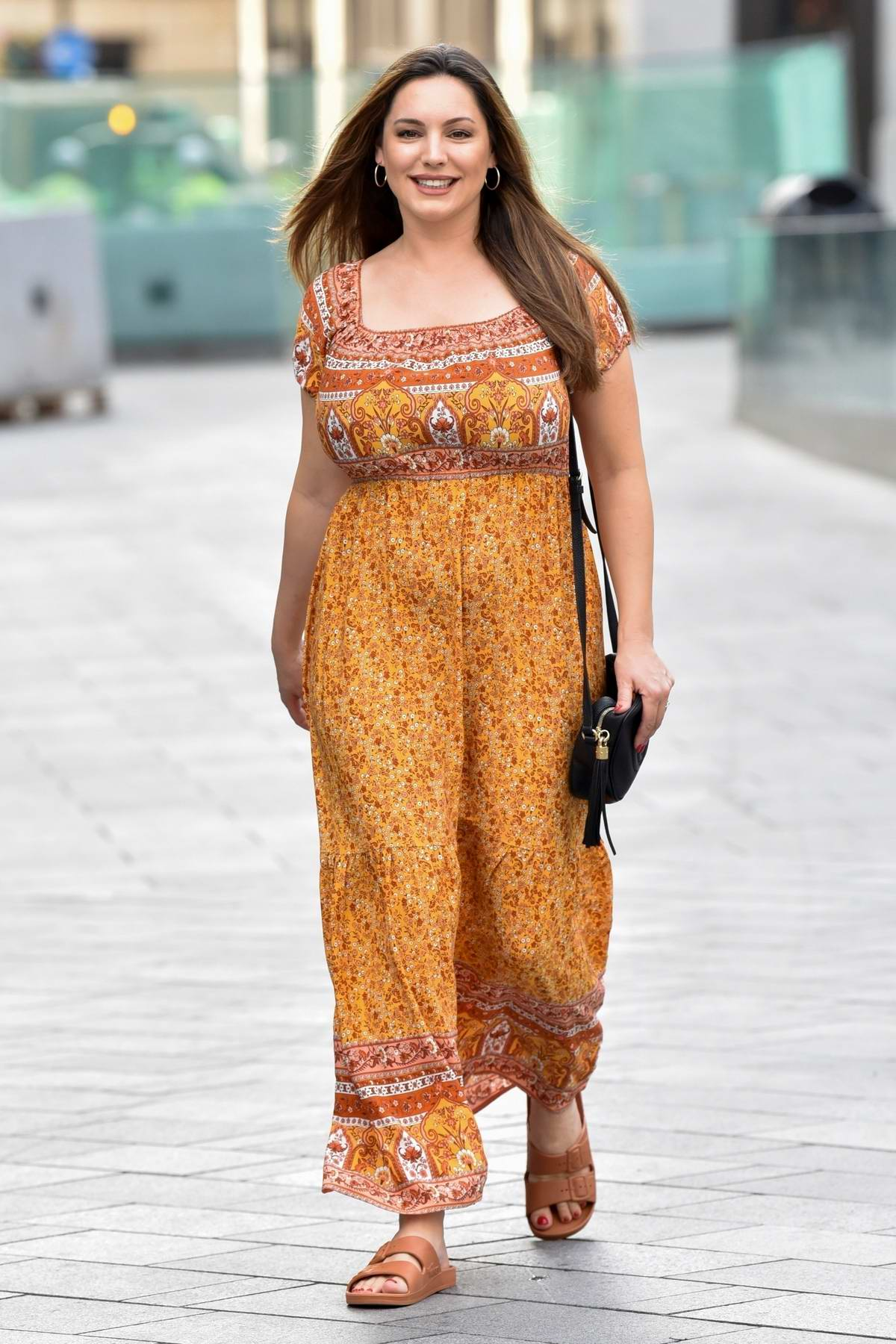 Kelly Brook looks lovely in a floral print summer dress while arriving at the Global Radio studios in London, UK