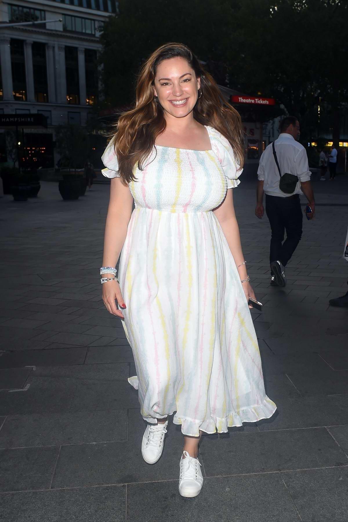 Kelly Brook looks radiant in white while leaving Global Radio Studios in London, UK