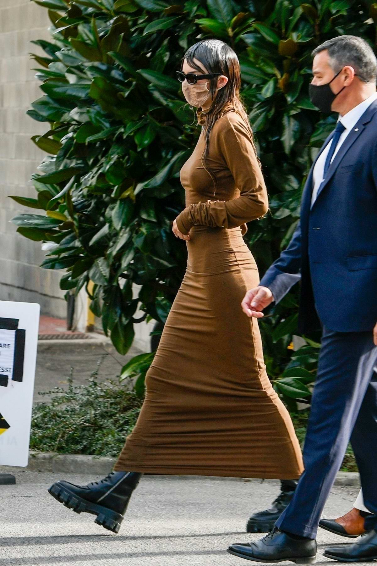 Kendall Jenner dons a form-fitting brown dress as she leaves a Versace fitting during Milan Fashion Week in Milan, Italy