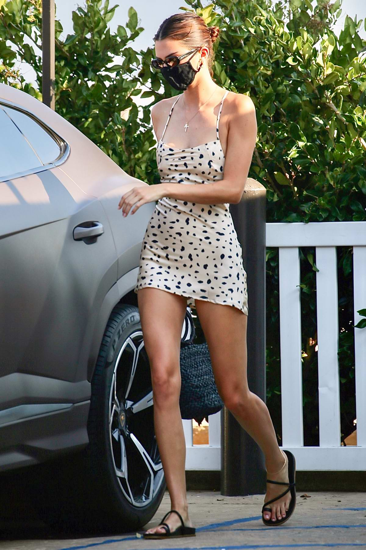 Kendall Jenner looks stunning in a mini dress as she leaves Nobu with Kylie Jenner and Devin Booker in Malibu, California