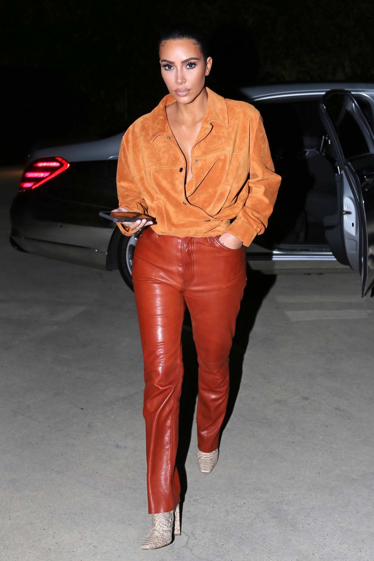 Kim Kardashian looks sleek in leather while visiting a friend in Malibu, California