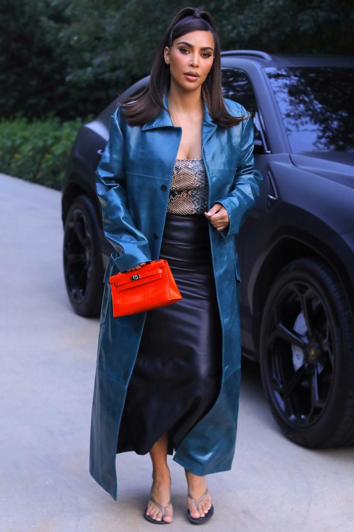 Kim Kardashian seen wearing a blue trench coat as she leaves a business meeting in Beverly Hills, California
