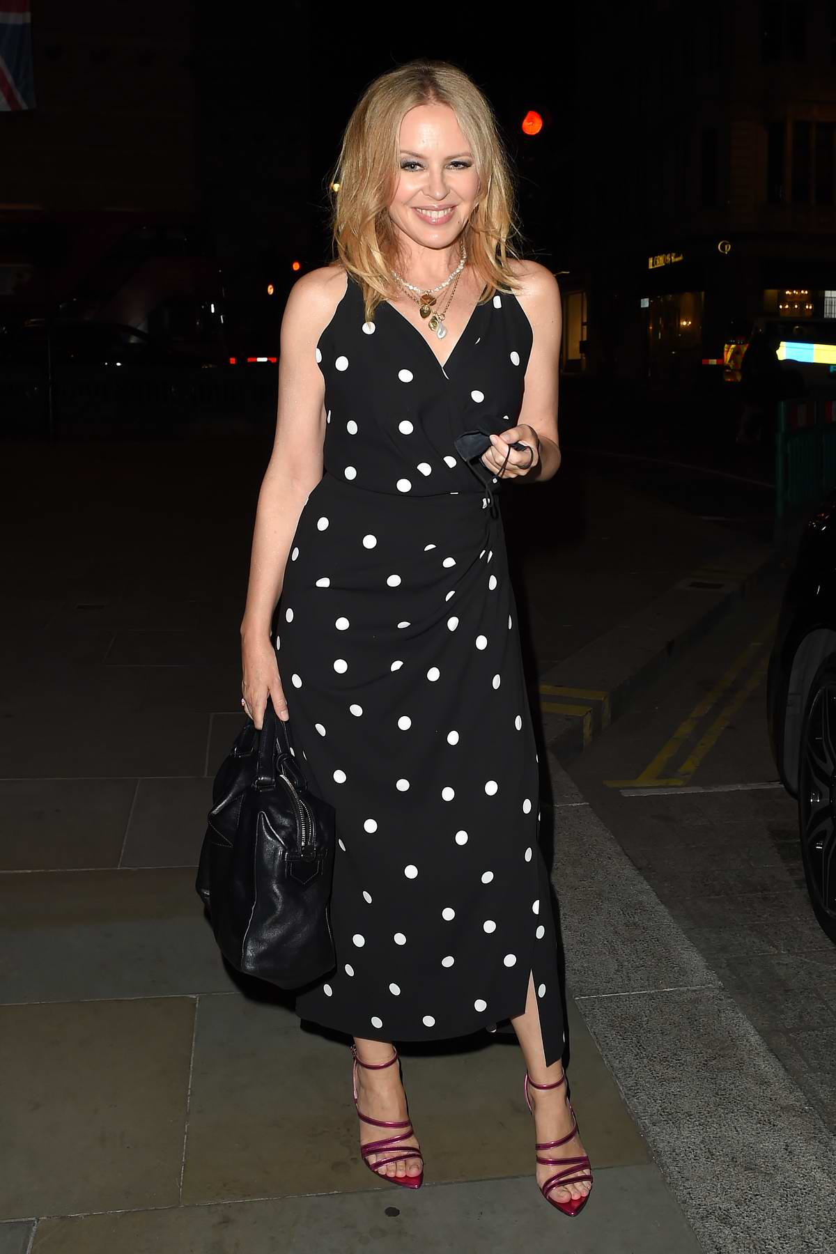Kylie Minogue wears a polka dot dress as she enjoys a night out at The Ritz Hotel in London, UK