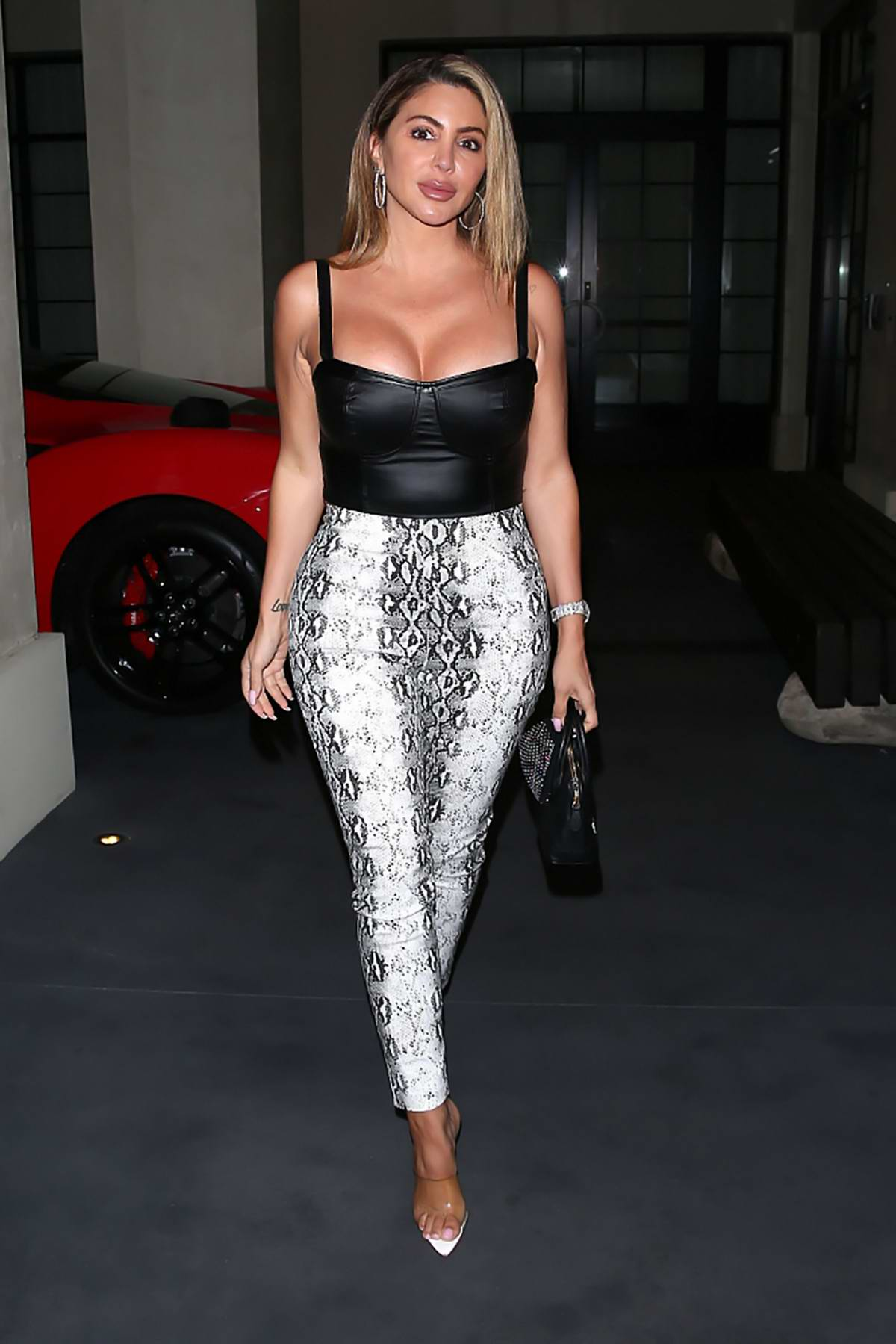 Larsa Pippen dons black leather top and snakeskin print pants as she leaves 'Olivetti' Restaurant in West Hollywood, California