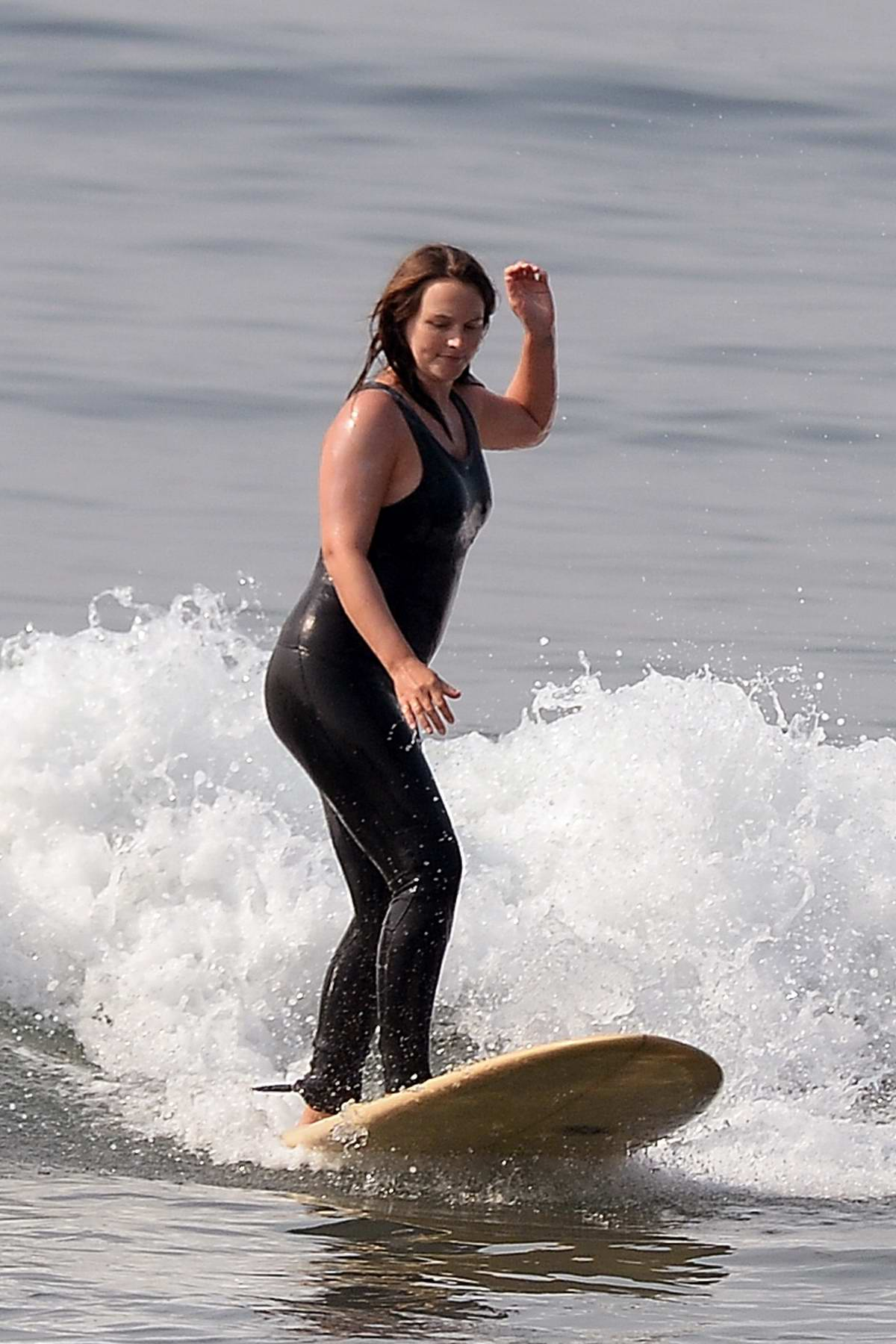 Leighton Meester shows off her impressive surfing skills in Malibu, California