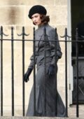 Lily James seen driving a vintage convertible Jaguar while filming for 'The Pursuit of Love' in Bath, Somerset, UK