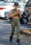 Lucy Hale wears green sports bra with matching leggings during a solo hike session in Studio City, California