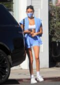 Madison Beer rocks a tiny crop top and shorts during a shopping trip with Nick Austin in West Hollywood, California