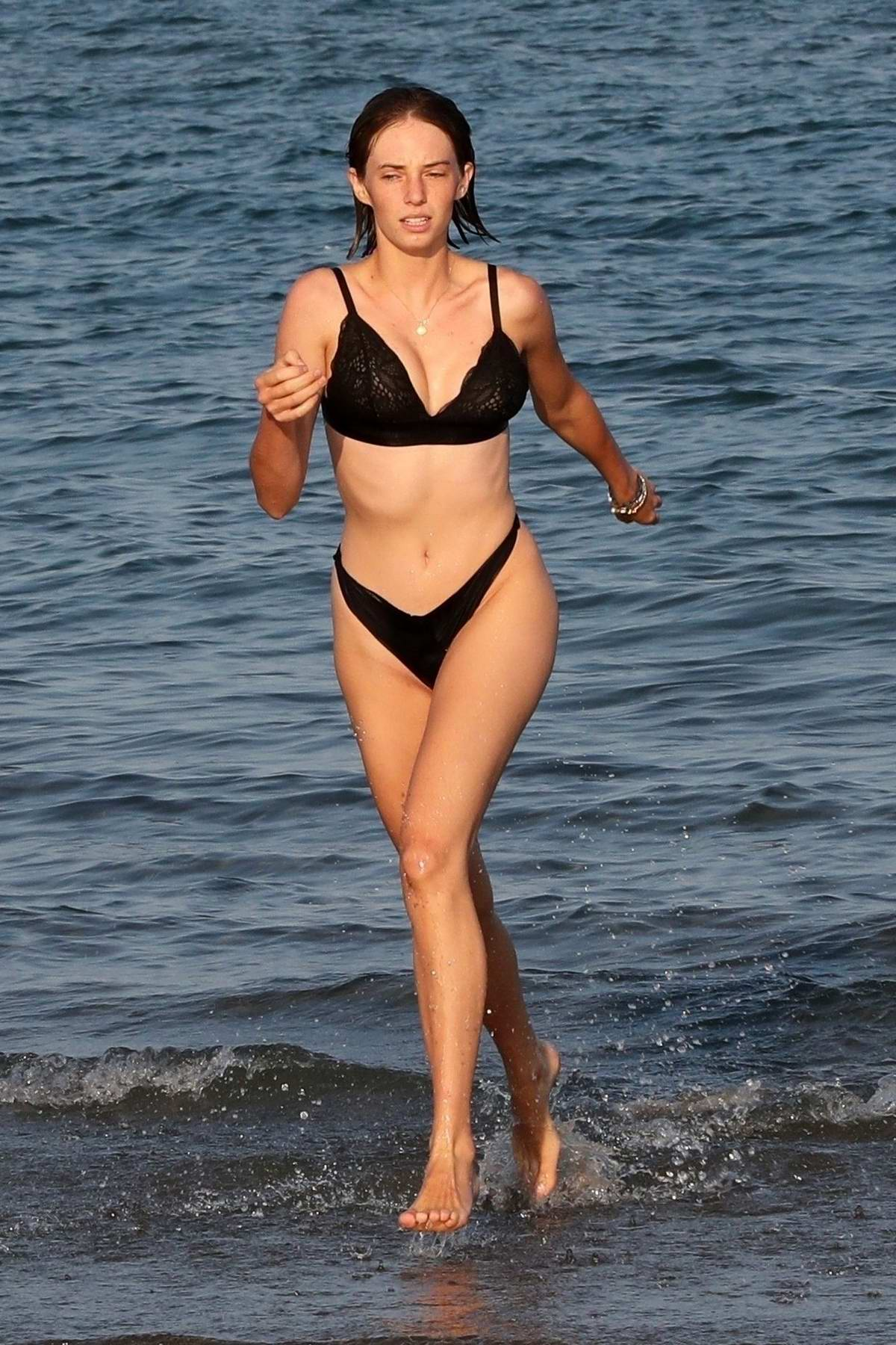Maya Hawke slips into a black bikini as she hits the beach in Venice, Italy