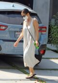Minka Kelly seen wearing long white dress as she leaves a friends house after a short visit in Los Angeles