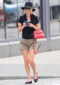 Nicky Hilton puts on a stylish display in animal print shorts with black top and hat while out on a stroll in New York City
