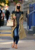 Nicky Hilton seen wearing a flannel lined trench coat while out in New York City